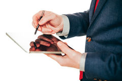 Close up image of business man holding a digital tablet Stock Photo