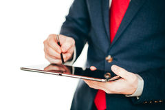 Close up image of business man holding a digital tablet Royalty Free Stock Images