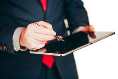 Close up image of business man holding a digital tablet Royalty Free Stock Image