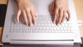 Typing on Notebook. Close up image of businessman hands typing on notebook, copy writer, working on laptop computer internet technology keyboard job online stock photography