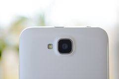 Close Up Image of the Camera of White Smart Phone Stock Photo