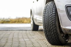 Close-up image of car wheel with black rubber tire.  Royalty Free Stock Photography
