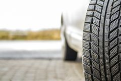 Close-up image of car wheel with black rubber tire.  Royalty Free Stock Photo