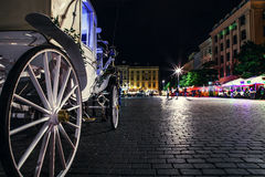Close up image carriage wheel on main square of olf city in Krak Royalty Free Stock Photos