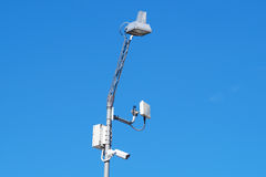 Close up image of CCTV security camera fixed on a pole metalic . Stock Photography