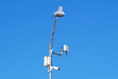 Close up image of CCTV security camera fixed on a pole metalic . Royalty Free Stock Image