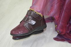 Close up of the feet. A close up image of celebration skirt and leather shoes. Party, new year, celebration Stock Image