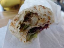 Close up image of a chicken shawarma wrap royalty free stock photography