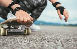 Close up image child hands holding skateboard stock images