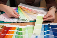 Close up image of color cards on architect desk. Architecture and construction. Color pallete Royalty Free Stock Photography