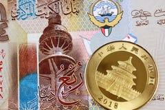 Kuwaiti Quarter Dinar Bank Note With A Chinese Gold Panda. A close up image of a colorful Kuwaiti quarter dinar bank note with a one ounce Chinese gold panda royalty free stock photo