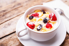 Close up image of corn flakes with berry and milk Stock Photo