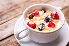 Close up image of corn flakes with berry and milk Royalty Free Stock Photo