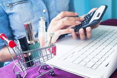 Close up image cosmetic, beauty items in shopping cart, woman`s Stock Image