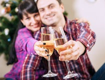 Close up image couple hands with bubble wine goblets Royalty Free Stock Photos