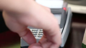 Close up image of a credit card being swiped through a card machine stock footage