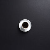 Close-up image of a cup of fresh coffee on black Royalty Free Stock Photo