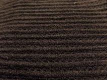 Close up of a dark knitted scarf stock photos