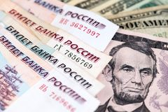 US Dollar and Russian Ruble currency banknotes. Close up image of Dollar with Russian Rubles banknotes. Close up image of Dollar with Russian Rubles banknotes stock images
