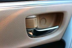 Close-up image of the door opening in the car  Beautiful design, modern  Car interior. Close-up image door opening car beautiful design modern interior royalty free stock photos