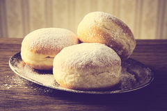 Close-up image doughnuts on tray in old-style wallpaper Royalty Free Stock Images