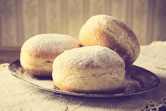 Close-up image doughnuts on tray in old-style wallpaper Stock Images