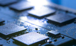 Close up Image of Electronic Circuit Board with Processors in Bright Light. Computer Technology Concept Background Royalty Free Stock Image