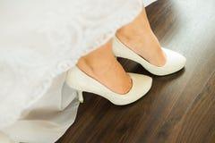 Close up image of elegant floor-length wedding dress Royalty Free Stock Photos