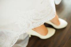 Close up image of elegant floor-length wedding dress Stock Image