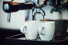 Close up image of espresso pouring into white cups Stock Photography