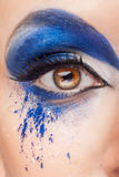 Close up image of an eye with blue fantasy make up Royalty Free Stock Images
