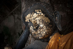 Close up image of the face of a Buddha statue.Defocused stock photo