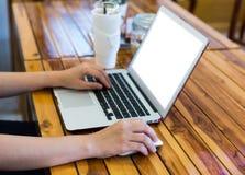 Close-up image of female hand writing on laptop Stock Photography