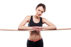 Close up image of female in sports clothing relaxing after worko Royalty Free Stock Images