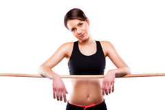Close up image of female in sports clothing relaxing after worko Stock Image
