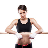 Close up image of female in sports clothing relaxing after worko Royalty Free Stock Photography