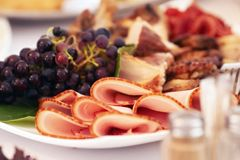 Close-up image of a festive table with different dishes. royalty free stock image