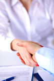 Close-up image of a firm handshake standing Royalty Free Stock Images