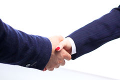 Close-up image of a firm handshake standing Stock Photos