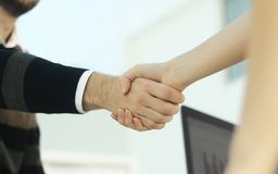 Image of a firm handshake stock image