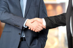 Close-up image of a firm handshake between two colleagues Stock Images