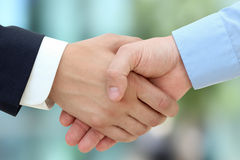 Close-up image of a firm handshake  between two colleagues on a Royalty Free Stock Photography