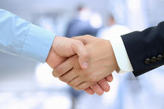 Close-up image of a firm handshake  between two colleagues on a Stock Images