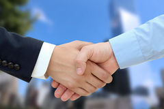 Close-up image of a firm handshake  between two colleagues on a Royalty Free Stock Photo