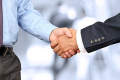 Close-up image of a firm handshake between two colleagues in off Stock Images
