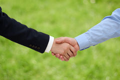 Close-up image of a firm handshake  between two colleagues in of Stock Photo