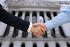 Close-up image of a firm handshake  between two colleagues in of Stock Photos