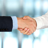 Close-up image of a firm handshake  between two colleagues in of Royalty Free Stock Image