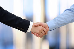 Close-up image of a firm handshake  between two colleagues in of Stock Image