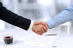 Close-up image of a firm handshake  between two colleagues in of Royalty Free Stock Photos